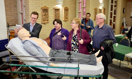 {Radiothon Supporters Try Out Medical Simulation}